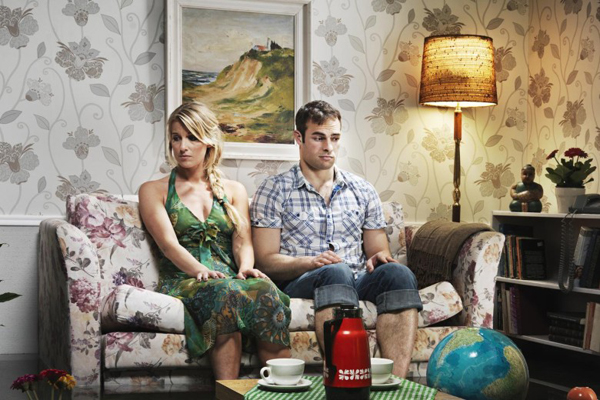 young-couple-in-sofa-in-a-flooded-room-